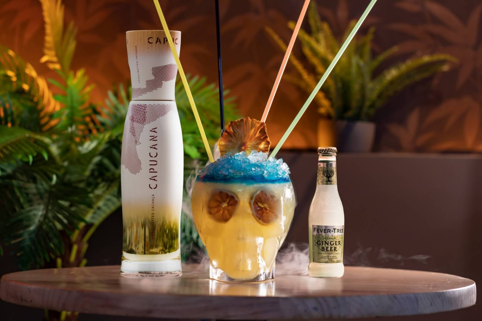"""ATTICO14 """"Nuestra propuesta para la B.C.Route: BURNING SKULL,CachaçaCapucana, Fever-Tree Premium GingerBeer, refresco de aloe vera, puré de fruta de la pasión, lima, zumo de piña y Blue Curaçao."""""""